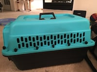 teal and black pet carrier 13 km