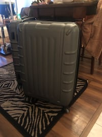 Four wheeled rolling suitcase