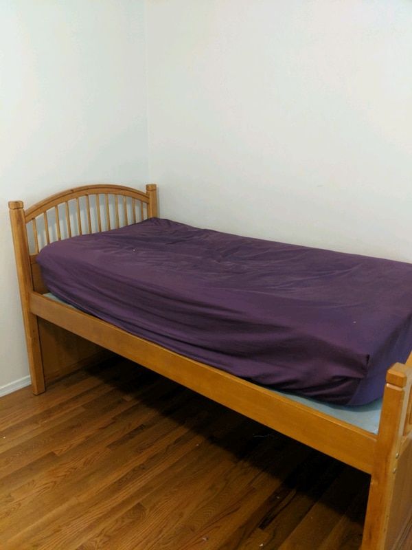 brown wooden bed frame with mattress af92a478-ba16-4dfe-8ebe-c2fa122896a1