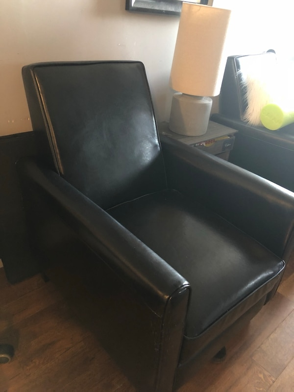 Black leather tufted sofa chair, recliner and very comfy. The best part is  that it's small so fits small spaces.