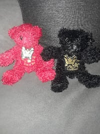 two red and black faux fur bear plush toys from This Is It Tour NORTON
