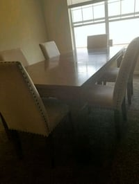 rectangular brown wooden table with six chairs din Stockbridge, 30281