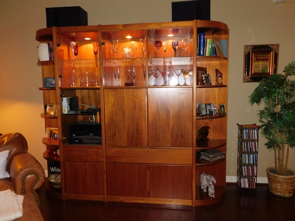 Teak Entertainment Center In Great Condition Top Section Is Lighted And Has Gl Doors