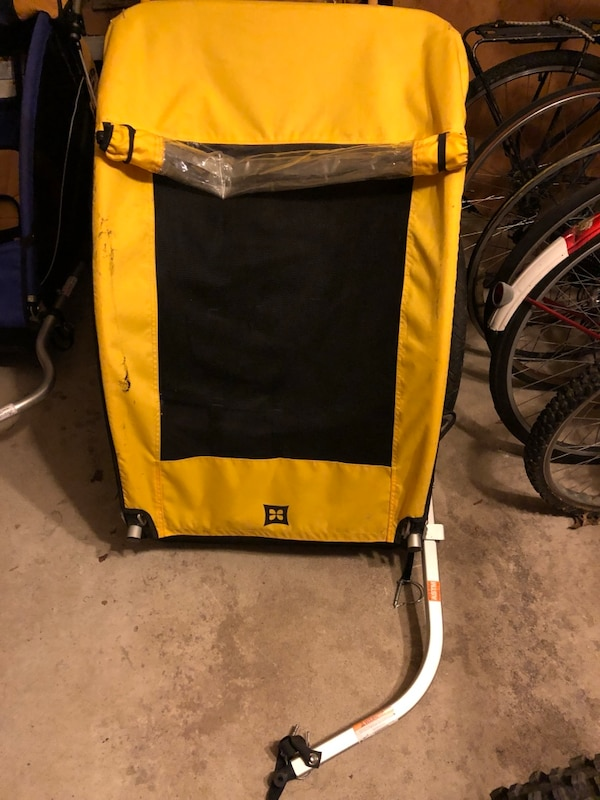 yellow and black bicycle trailer a30a97bd-ef07-48dc-86d2-23beb2d19db4