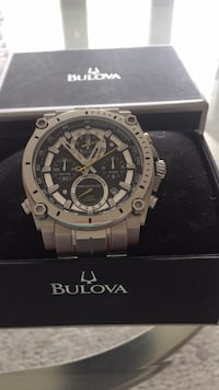 round silver chronograph watch with black leather strap Edmonton, T5T 4G9