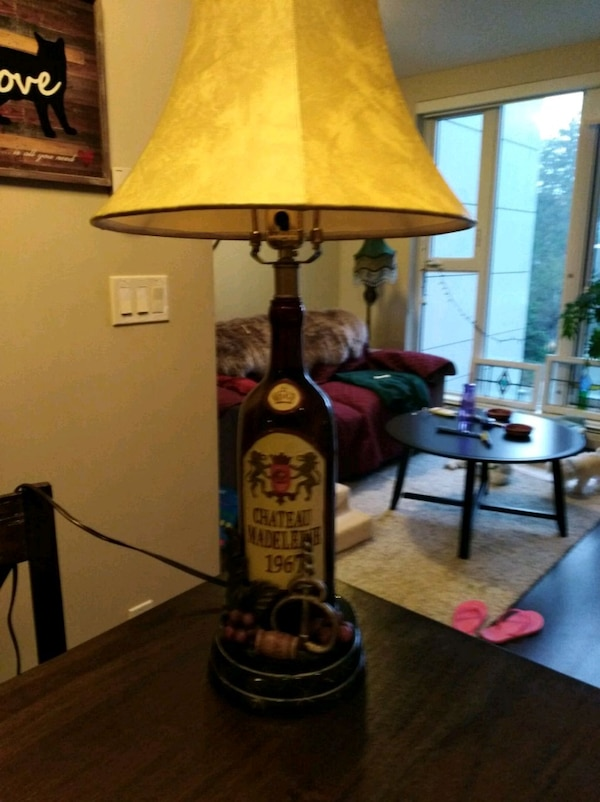 wine bottle table lamp good condition. Works 931fb77c-a172-407e-8c2b-22af6a4c2a6f