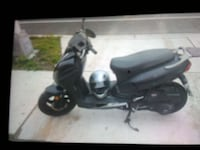 gray and black motor scooter with black and gray full face helmet Baltimore, 21224