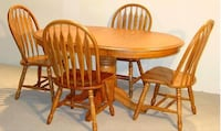 oval brown wooden table with four chairs dining set Brampton, L6T 5G2