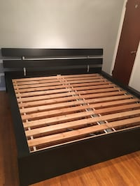 black and brown wooden bed frame Burnaby, V5B 2L7