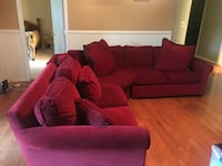 red fabric sectional sofa with throw pillows Germantown