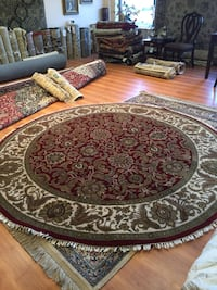round brown and black floral area rug