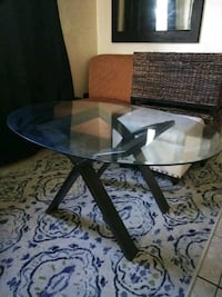 round glass-top table with black steel base Gainesville, 32601
