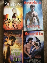 4 romance novels, in next to new shape.