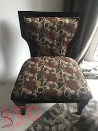 black and brown floral padded chair