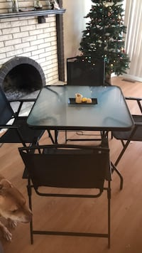 black metal framed glass top table with chairs set Richmond, V7E 5C9