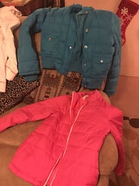 teal and pink full-zip bubble jackets