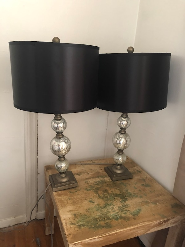 two black base table lamps with white lampshades