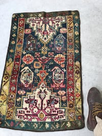 Antique rugs Black, red, and green floral textile New York, 10468