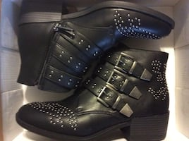 Studded black boot. New never worn