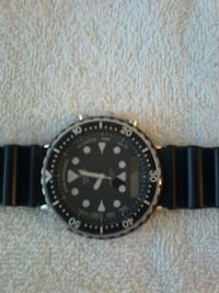 round silver-colored analog watch with black strap Vancouver, V6C 3R3
