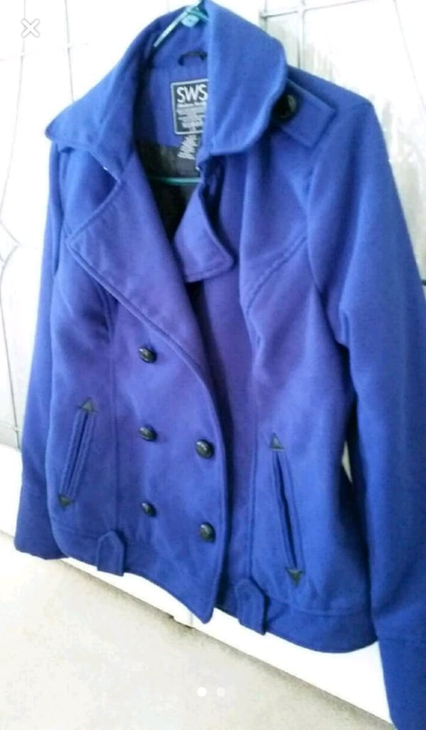 Womans Blue coat 121ef4d2-76f2-48dd-919d-b5ceef4eaff8