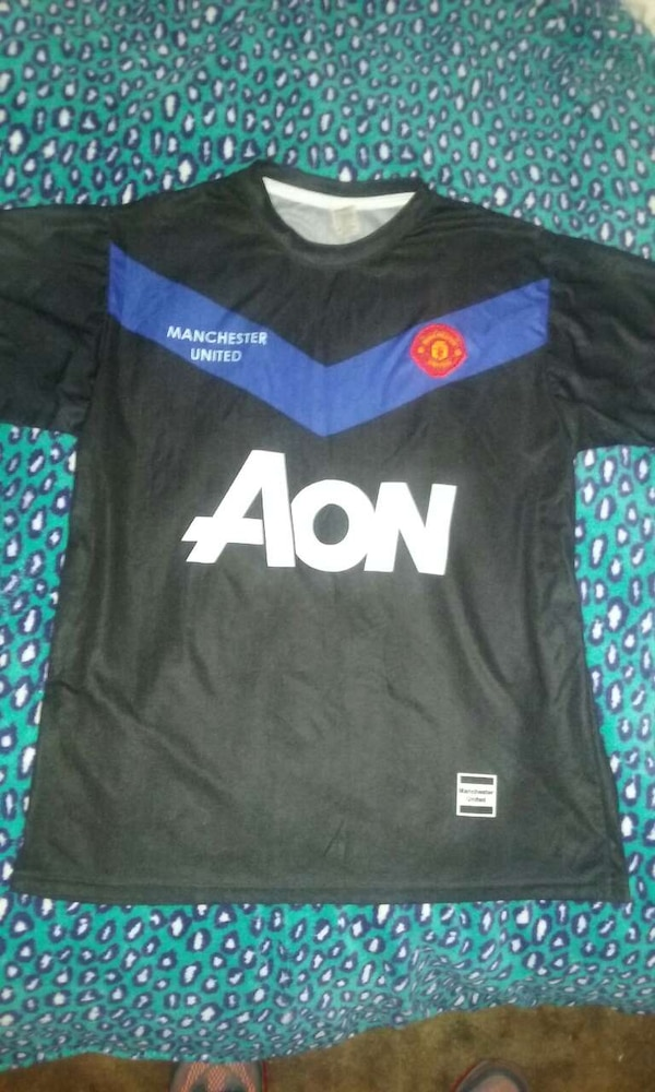 free shipping 94b5d c12dd black Manchester United Aon soccer jersey