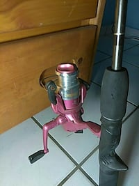 pink and gray fishing reel