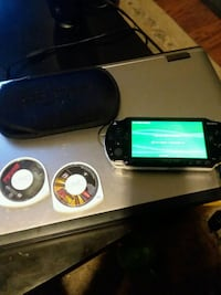 Mint PsP comes with 1 game 1 movie case and chargi Salt Lake City