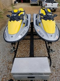 yellow and black personal watercraft