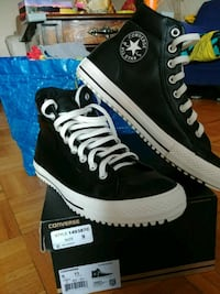 pair of black Converse All Star high-top sneakers