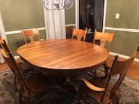 Oval brown wooden table with chairs dining set Ashburn