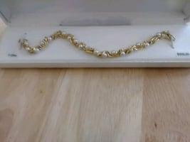 Gold plated and fashionable pearls bracelet.