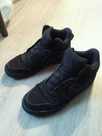 pair of black Nike high-top sneakers