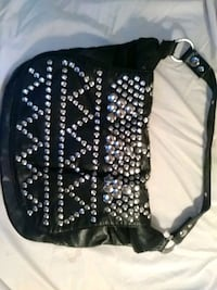 BCBGblack leather handbag used once in perfect sha Rossville, 30741