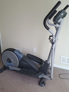 gray and black Weslo Pro elliptical trainer