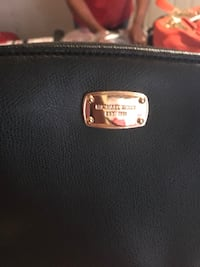 black Micheal Kors leather wallet