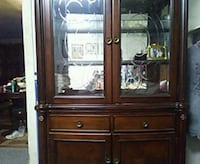brown wooden framed glass china cabinet Topeka, 66605
