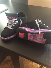 black-and-pink Air Jordan basketball shoes
