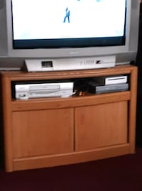 gray CRT television with brown wooden TV stand Mount Vision, 13810