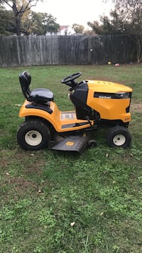 yellow and black ride on lawn mower