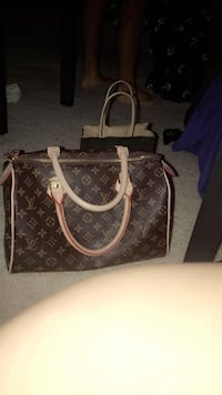 Brown louis vuitton leather tote bag Noblesville, 46060