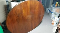 oval brown wooden dining table Toronto, M4Y 3A6