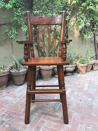 All 100% Wooden baby chair fantastic quality in excellent condition Lahore