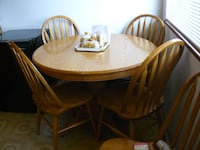 Solid oak table with leaf and 5 chairs  Vancouver, V5V 2H6