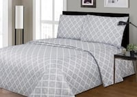 white and gray bed sheet null