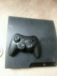 black Sony PS3 slim console with controller 2355 mi
