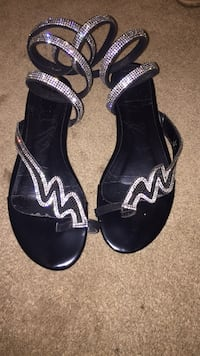 pair of black leather sandals London, N5Z