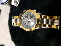 round black chronograph watch with gold link brace 3120 km