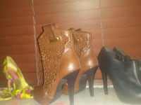 pairs of women's brown and black leather stilettos Surrey, V3W 5R4