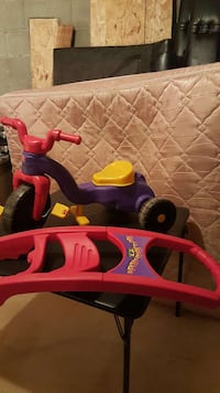 toddler's purple yellow and red plastic trike